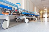 stock photo of icu  - long corridor in hospital with surgical transport - JPG