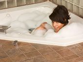 Girl Relaxing In Foam Bath