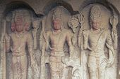 stock photo of ellora  - Images of the Hindu gods Brahma Vishnu and Shiva carved into solid rock inside an ancient cave temple Ellora Caves near aurangabad India - JPG