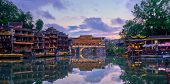 Chinese tourist attraction destination - panorama of Feng Huang Ancient Town (Phoenix Ancient Town)  poster