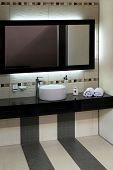 stock photo of lavabo  - Luxury bathroom with modern basin and big mirror - JPG