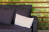 Favorite Seat On A Lounge Sofa In A Green Patio, A Tranquil Place For Relaxation And Recreation poster
