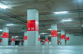 Empty Underground Car Parking Lot. Underground Car Parking Garage At Shopping Mall Or International  poster