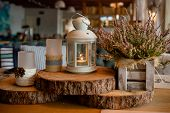 Pink Heather.cozy Home Autumn Mood .wooden Table With Autumn Decor, Lantern, Candles And Flowers.hea poster