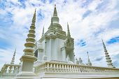 White Pagoda (chedi Or Stupa) With Blue Sky Background poster