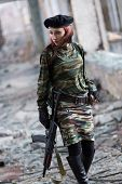 Soldier Girl With Weapons In Camouflage Uniform In A Destroyed Building. The Concept Of Service In T poster