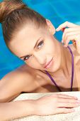 foto of close-up  - Close up of young adorable woman in swimming pool - JPG