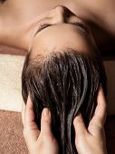 Cosmetologist massaging hair on the head of the woman. Spa treatments. Beauty treatment. Spa salon poster