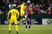 CARSON, CA. - APRIL 9: Chivas USA M Ben Zemanski #21 and Columbus Crew F Emilio Renteria #20 during