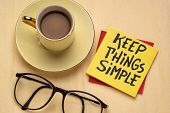 Keep things simple - handwriting on a reminder note with a cup of coffee, efficiency or minimalism c poster