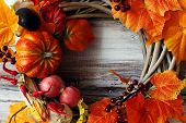 Decorative Wreath, Autumn Theme With Leaves And Pumpkins, In Honor Of Halloween. poster