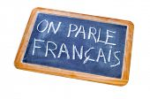 sentence french is spoken written in french on a chalkboard