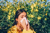 Woman Got Nose Allergy, Flu Sneezing Nose. The Girl Suffers From Pollen Allergy During Flowering And poster