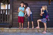 Kids Gossiping. Girl Whispering Something To The Boy, Other Girl Eavesdropping. Kids Playing, Playfu poster