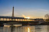 Paris France City Skyline Sunrise At Eiffel Tower And Seine River With Pont De Bir-hakeim Bridge And poster