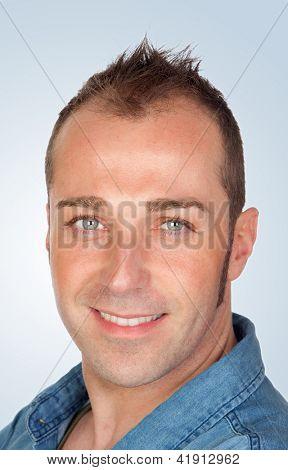 Sympathetic man smiling isolated on blue background