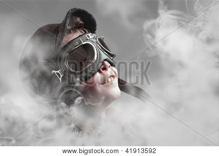 Boy pilot smiling into smoke