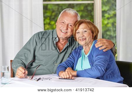 Portrait of happy old senior couple in a retirement home