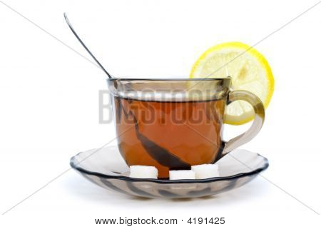Teacup With Black Tea And Lemon