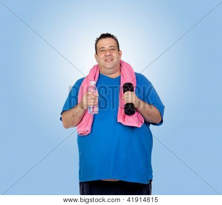 Fat man in the gym with a water bottle isolated on a blue background