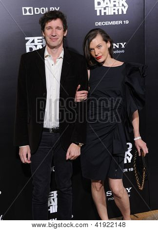 LOS ANGELES - DEC 09:  Milla Jovovich & Paul W.S. Anderson arrives to the