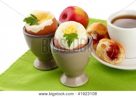 Light breakfast with boiled eggs and cup of coffee, isolated on white