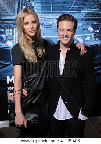 LOS ANGELES - JAN 23:  ASHTON HOLMES & DATE arriving to