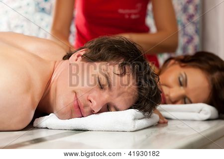 Wellness - a young couple getting a massage in their vacation