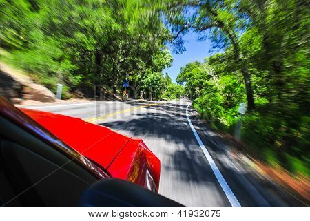 Sports Car Zooming along Rural Road