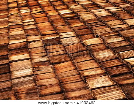 Old wood shingle roof with texture and brown color