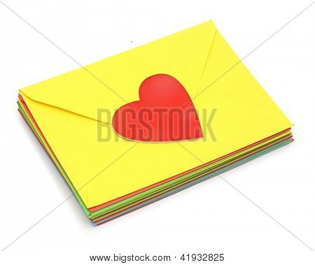A red heart on pile colorful envelopes over white background