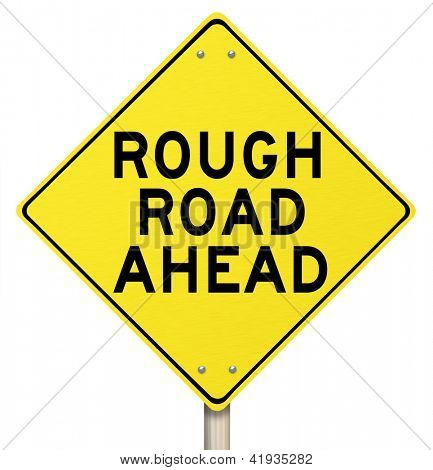 A yellow diamond-shaped road sign cautions people that rough roads are ahead