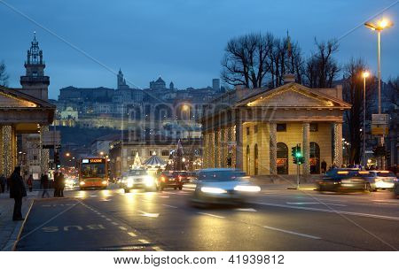 BERGAMO, ITALY - JANUARY 1: People on the main street against historic Citta Alta in Bergamo, Italy on January 1, 2013.The city is one of candidates to be European capital of culture in 2019