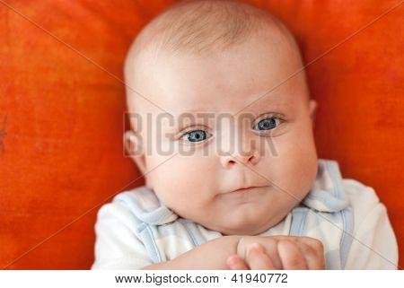 Adorable Baby Child On Orange Background