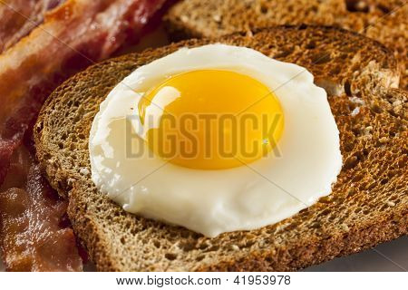 Organic Sunnyside Up Egg With Toast And Bacon