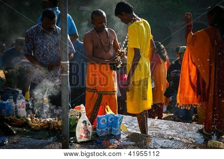 KUALA LUMPUR - JANUARY 27: A Hindu priest prays and blesses a devotee before his cleansing ceremony at Batu Caves temple in Malaysia on January 27, 2013 during the Thaipusam festival.
