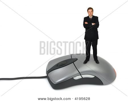 Businessman On Computer Mouse