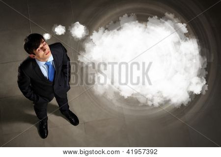 Top view of young businessman making decision with place for text