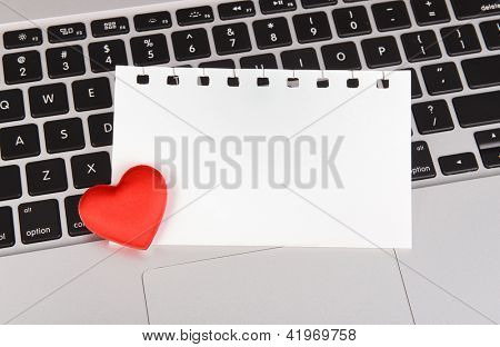red hearts and sticky note on Laptop keyboard