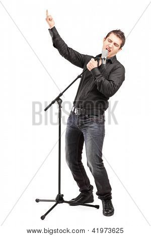 Full length portrait of a male singer performing a song isolated on white background