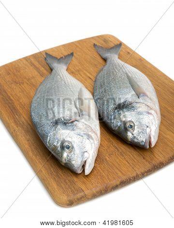 Dorado Fish On A Cutting Board On A White Background