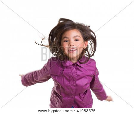 Asian child girl jumping happy with winter purple coat moving hair on white