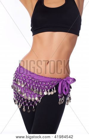 Belly Dancer Wearing a Purple Coin Belt and Workout Clothing