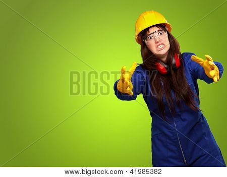 Portrait Of A Frustrated Female Worker On Green Background