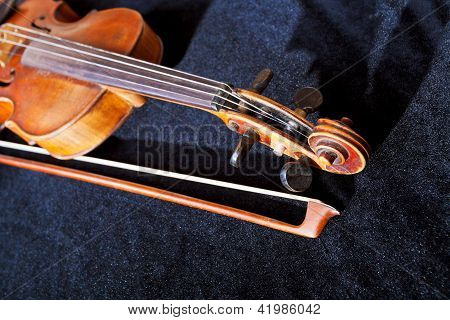 Violin Pegbox And Bow On Black Velvet Background