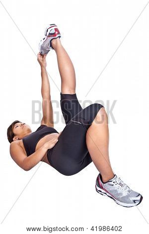 Fitness woman stretching hamstring while lying on floor