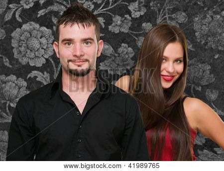 Portrait Of Happy Couple On Wallpaper, Indoors