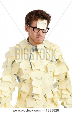 Young male with a sticky note on his face, covered with yellow sticky notes, isolated on white