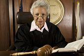 image of courtroom  - Senior judge sitting with book in courtroom - JPG