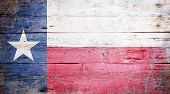 stock photo of texas  - Flag of the State of Texas painted on grungy wooden background - JPG